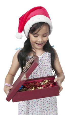 Happy daughter smiling when open christmas box photo