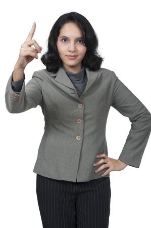 female boss: Weibliche Chef ver�rgert, indem mit dem Finger �ber wei�em Hintergrund Lizenzfreie Bilder