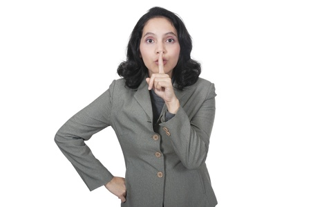 Mixed asian caucasian business woman gesture a secret isolated over white background Stock Photo - 13901246