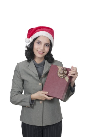 Mixed race caucasian asian woman hold christmas box photo