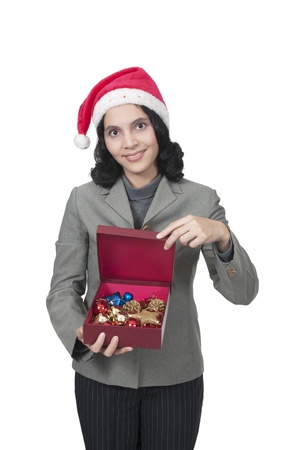 Mixed race caucasian asian woman hold christmas box photo