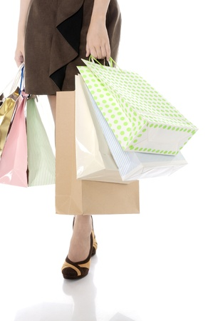 Woman legs with a lot of shopping bag isolated over white background photo