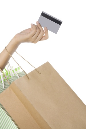 Woman hand hold shopping bag and ready to pay with credit card