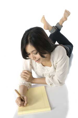 barefoot women: Pretty asian woman write on the floor, isolated over white background