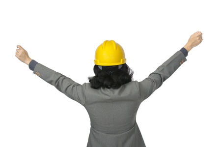 Woman in yellow hat raise her hand isolated over white background photo