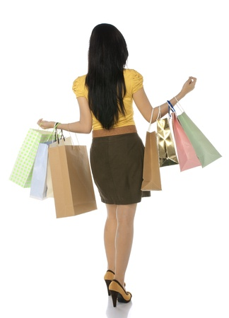 Full body shoot from back asian woman hold shopping bags isolated over white body photo