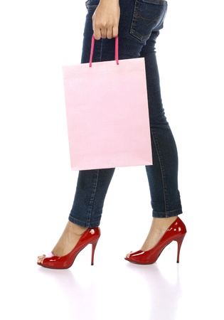 Shopping bag, jeans, and high heels closeup with copy space on shopping bag  Shopping woman profile close up isolated on white background, Stock Photo - 14250614