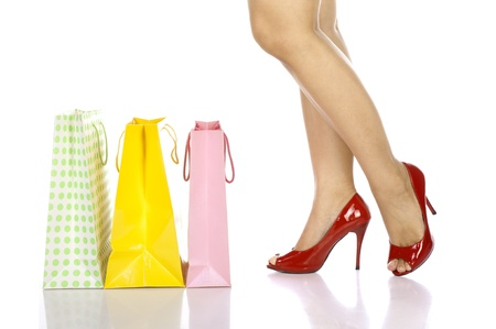 Shopping bag , Legs and high heels close up isolated on white background, photo