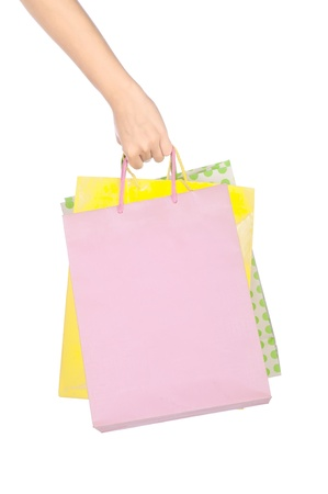 Woman hand holding shopping bag isolated over white background photo