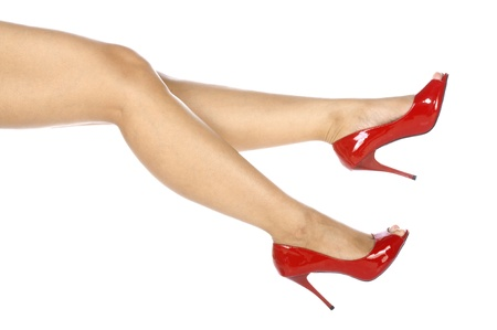 Woman wearing red shoes isolated over white background Stock Photo - 14250608