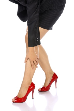 Business woman got her injured legs because wearing high heels