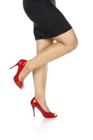 Woman wearing red shoes isolated over white background photo