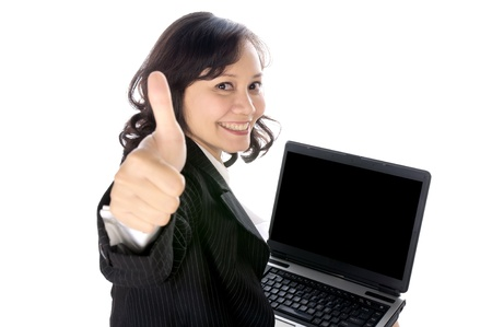 Woman happy giving thumbs up with excited expression. She using laptop pc isolated over white background photo
