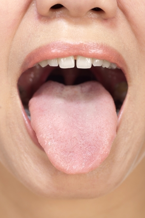 Woman stick ones tongue out isolated in white Stock Photo