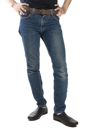 Man wearing jeans and shoes isolated over white background photo