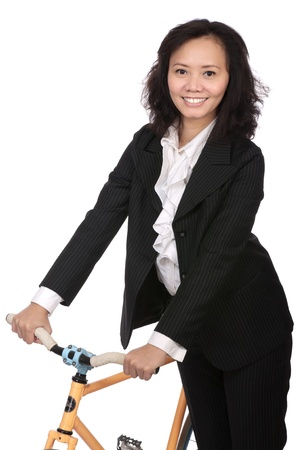 Asian business woman using bike to go work photo