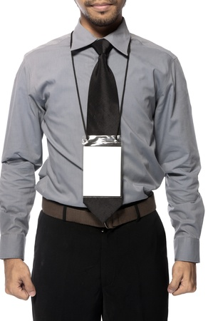 Blank badge hanging on business man torso photo