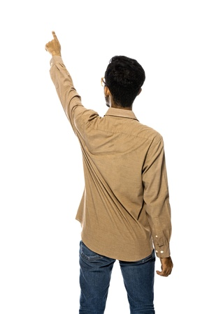 Asian business man pointing something from back isolated over white background photo