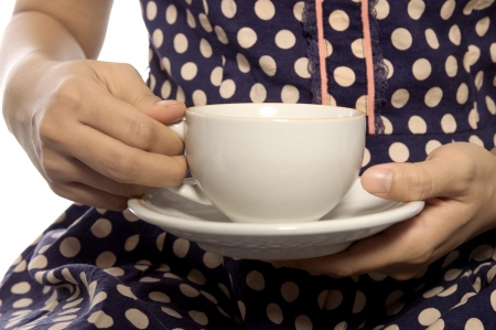 Woman wearing retro dress hold a cup of coffee photo