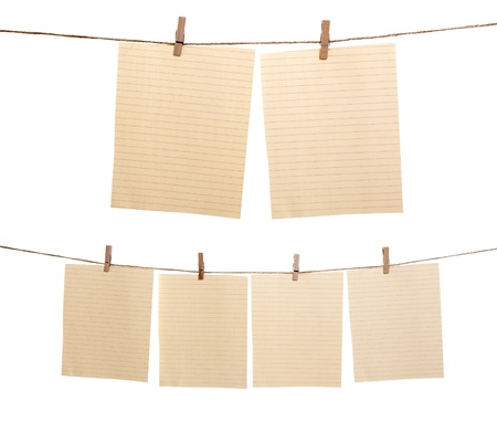 clamp: Collection of paper sheet hanging on the rope isolated over white background