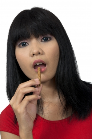 Asian woman eat snack isolated over white background photo