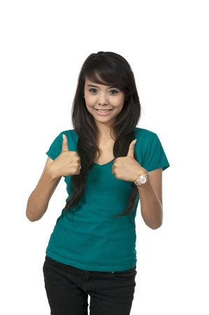 Asian woman in green shirt, give thumbs up isolated over white background photo
