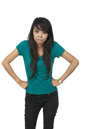 Asian woman in green shirt, posing isolated over white background photo