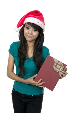Asian woman holding christmas gift box isolated over white background photo