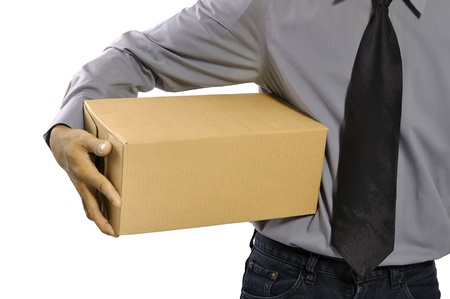 package shipment: A businessman holding a package parcel isolated on white