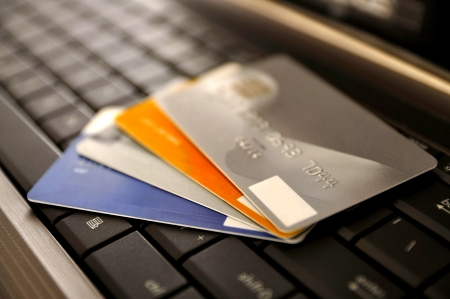 E-commerce concept. group of credit cards and laptop with shallow DOF Stock Photo