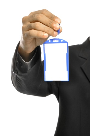 A businessman holding a blank name tag and a sharp business suit. photo
