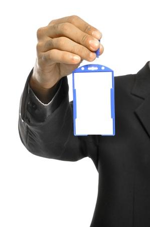 Een zakenman die een blanco naamplaatje en een scherpe pak. Stockfoto - 15157944