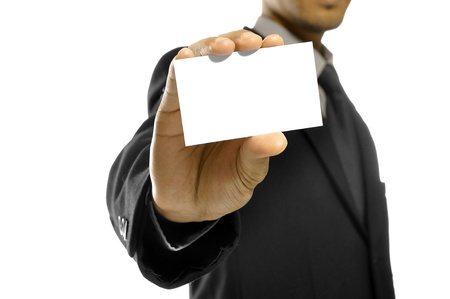 Business man holding name card isolated over white background photo