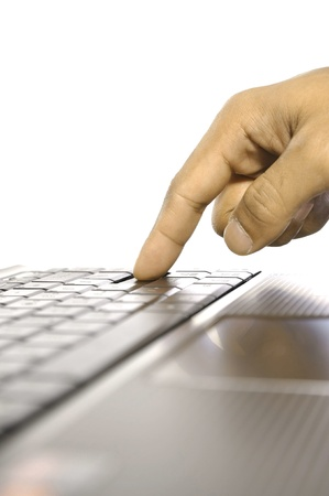 Man touching laptop button. Shot with shallow DOF photo