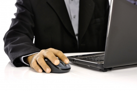 Man typing on laptop isolated over white background Stock Photo - 15352616
