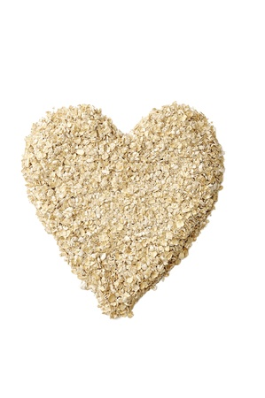 Heart shape oatmeal isolated over white background photo