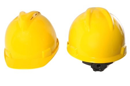 Two yellow construction helmet isolated over white background photo