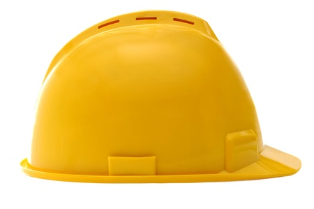 Yellow construction helmet isolated over white background Stock Photo - 15701332