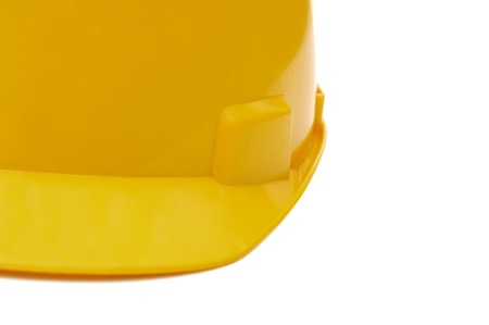 Yellow construction helmet isolated over white background photo