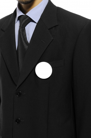 Man with black business suit with blank pinned button  You can put your design on the button  Election day background or concept Stock Photo - 15717840