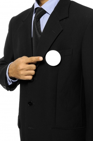Man with black business suit with blank pinned button  You can put your design on the button  Election day background or concept Stock Photo - 15717831
