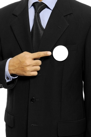 Man with black business suit with blank pinned button  You can put your design on the button  Election day background or concept Stock Photo - 15717836