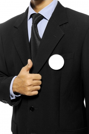 Man with black business suit with blank pinned button give thumb up  You can put your design on the button  Election day background or concept Stock Photo - 15717839