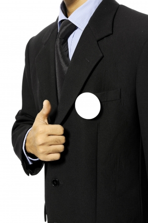 Man with black business suit with blank pinned button give thumb up  You can put your design on the button  Election day background or concept Stock Photo - 15717834