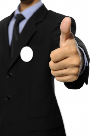 Man with black business suit with blank pinned button give thumb up  You can put your design on the button  Election day background or concept Stock Photo - 15717832