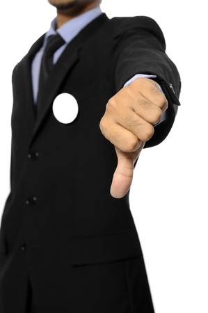 Man with black business suit with blank pinned button give thumb down  You can put your design on the button  Election day background or concept Stock Photo - 15717830