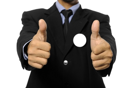 Man with black business suit with blank pinned button give thumb up  You can put your design on the button  Election day background or concept Stock Photo - 15717843