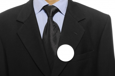 Man with black business suit with blank pinned button  You can put your design on the button  Election day background or concept Stock Photo - 15717842