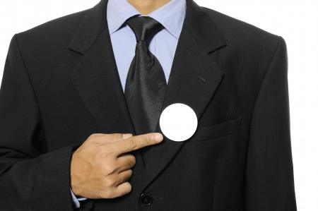 Man with black business suit with blank pinned button  You can put your design on the button  Election day background or concept Stock Photo - 15717837