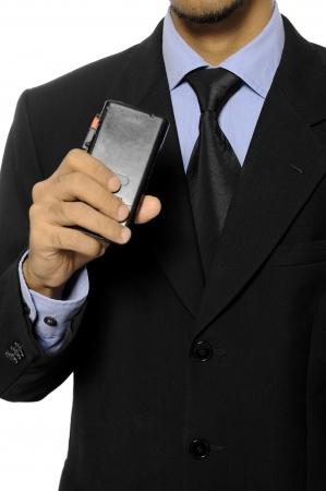 dictating: Hombre de negocios hablando en una grabadora de dict�fono aislado sobre fondo blanco Foto de archivo